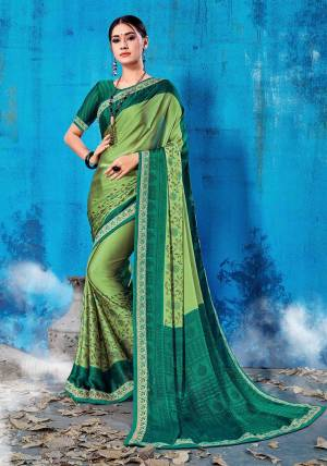 Add This Lovely Printed Saree To Your Wardrobe In Green Color Paired With Pine Green Colored Blouse. This Saree And Blouse Are Soft Silk Based Which Is Durable And Gives A Rich Look To Your Personality. Buy Now.