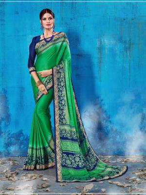 Add This Lovely Printed Saree To Your Wardrobe In Green Color Paired With Navy Blue Colored Blouse. This Saree And Blouse Are Soft Silk Based Which Is Durable And Gives A Rich Look To Your Personality. Buy Now.
