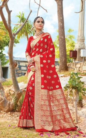 Get Ready For The Upcoming Wedding & Festive Season With This Pretty Saree In Red Color Paired With Red Colored Blouse. This Saree And Blouse Are Fabricated On Art Silk Beautified With Weave All Over. Its Lovely Color and Weave Will Give An Attractive Look To Your Personality.