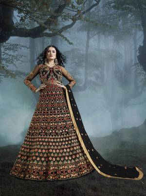 Grab This Heavy Designer Floor Length Suit In Black Color For The Upcoming Wedding Season. This Very Beautiful And Heavy Embroidered Floor Length Top Is Fabricated On Net Paired With Silk based Bottom And Net Fabricated Dupatta. Its Detailed Embroidery With Perfect Color Combination Will Earn You Lots Of Compliments From Onlookers.