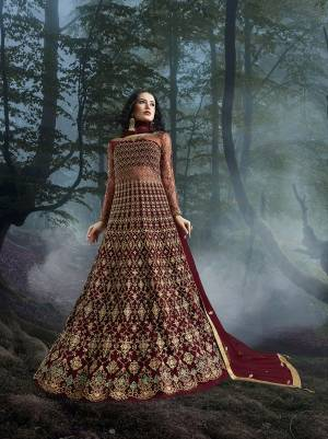 Grab This Heavy Designer Floor Length Suit In Maroon Color For The Upcoming Wedding Season. This Very Beautiful And Heavy Embroidered Floor Length Top Is Fabricated On Net Paired With Silk based Bottom And Net Fabricated Dupatta. Its Detailed Embroidery With Perfect Color Combination Will Earn You Lots Of Compliments From Onlookers.