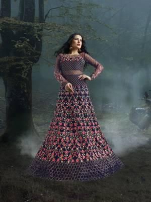 Grab This Heavy Designer Floor Length Suit In Violet Color For The Upcoming Wedding Season. This Very Beautiful And Heavy Embroidered Floor Length Top Is Fabricated On Net Paired With Silk based Bottom And Net Fabricated Dupatta. Its Detailed Embroidery With Perfect Color Combination Will Earn You Lots Of Compliments From Onlookers.