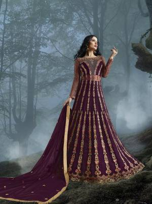 Grab This Heavy Designer Floor Length Suit In Wine Color For The Upcoming Wedding Season. This Very Beautiful And Heavy Embroidered Floor Length Top Is Fabricated On Net Paired With Silk based Bottom And Net Fabricated Dupatta. Its Detailed Embroidery With Perfect Color Combination Will Earn You Lots Of Compliments From Onlookers.
