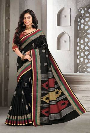 Celebrate This Festive Season With Beauty And Comfort Wearing This Pretty Saree In Black Color Paired With Red Colored Blouse. This Saree And Blouse Are Fabricated On Handloom Silk Which Is Light Weight, Durable And Easy To Carry All Day Long.
