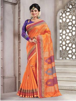 Add This Pretty Rich And Elegant Looking Saree In Orange Color Paired With Contrasting Purple Colored Blouse. This Saree And Blouse are Handloom Silk Based Beautified With Weave. Buy This Saree Now.