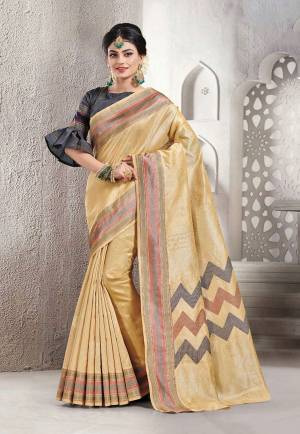 Celebrate This Festive Season With Beauty And Comfort Wearing This Pretty Saree In Cream Color Paired With Dark Grey Colored Blouse. This Saree And Blouse Are Fabricated On Handloom Silk Which Is Light Weight, Durable And Easy To Carry All Day Long.