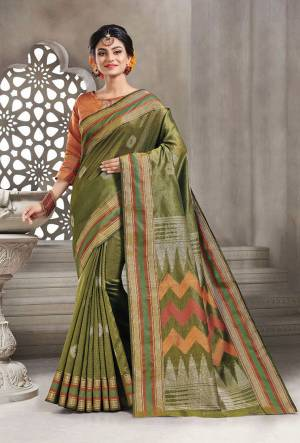 Add This Pretty Rich And Elegant Looking Saree In Olive Green Color Paired With Contrasting Rust Orange Colored Blouse. This Saree And Blouse are Handloom Silk Based Beautified With Weave. Buy This Saree Now.
