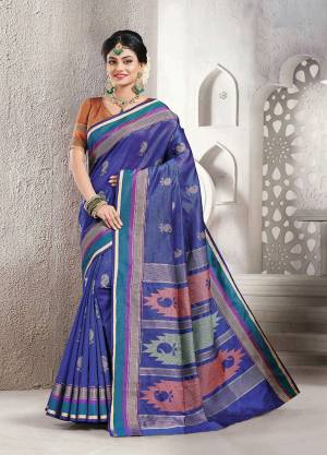 Celebrate This Festive Season With Beauty And Comfort Wearing This Pretty Saree In Blue Color Paired With Brown Colored Blouse. This Saree And Blouse Are Fabricated On Handloom Silk Which Is Light Weight, Durable And Easy To Carry All Day Long.