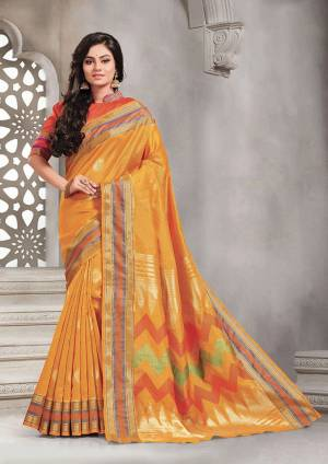 Add This Pretty Rich And Elegant Looking Saree In Musturd Yellow Color Paired With Contrasting Orange Colored Blouse. This Saree And Blouse are Handloom Silk Based Beautified With Weave. Buy This Saree Now.
