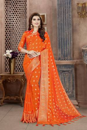 Celebrate This Festive Season In This Attractive Bright Orange Colored Saree. This Saree And Blouse Are Fabricated On Art Silk Beautified With Weaving And Stone Work. This Silk Based Saree Gives A Rich Look To Your Personality.