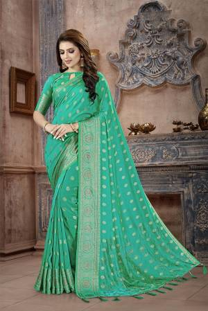 Celebrate This Festive Season In This Attractive Green Colored Saree. This Saree And Blouse Are Fabricated On Art Silk Beautified With Weaving And Stone Work. This Silk Based Saree Gives A Rich Look To Your Personality.