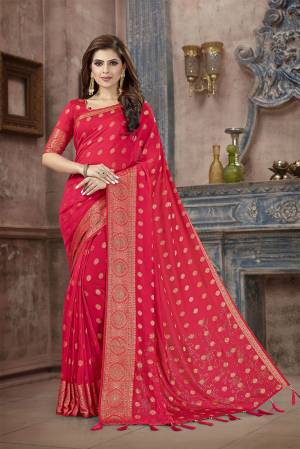 Celebrate This Festive Season In This Attractive Rani Pink Colored Saree. This Saree And Blouse Are Fabricated On Art Silk Beautified With Weaving And Stone Work. This Silk Based Saree Gives A Rich Look To Your Personality.