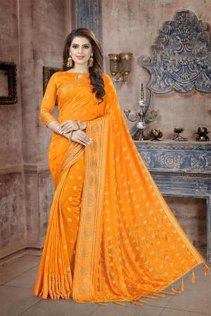 Celebrate This Festive Season In This Attractive Orange Colored Saree. This Saree And Blouse Are Fabricated On Art Silk Beautified With Weaving And Stone Work. This Silk Based Saree Gives A Rich Look To Your Personality.