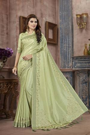 You Will Definitely Earn Lots Of Compliments Wearing This Designer Saree In Pastel Green Color. This Pretty Saree And Blouse Are Silk Fabricated on Manipuri Art Silk Beautified With Attractive Stone Work Giving It A Rich And Subtle Look. Buy Now.