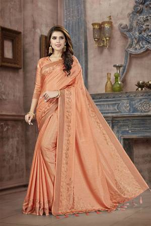 You Will Definitely Earn Lots Of Compliments Wearing This Designer Saree In Light Orange Color. This Pretty Saree And Blouse Are Silk Fabricated on Manipuri Art Silk Beautified With Attractive Stone Work Giving It A Rich And Subtle Look. Buy Now.