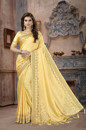 You Will Definitely Earn Lots Of Compliments Wearing This Designer Saree In Yellow Color. This Pretty Saree And Blouse Are Silk Fabricated on Manipuri Art Silk Beautified With Attractive Stone Work Giving It A Rich And Subtle Look. Buy Now.