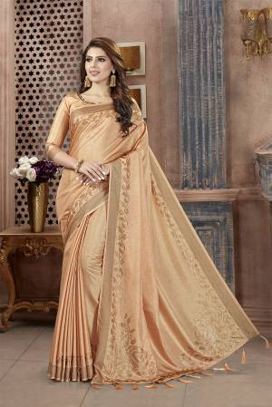 You Will Definitely Earn Lots Of Compliments Wearing This Designer Saree In Beige Color. This Pretty Saree And Blouse Are Silk Fabricated on Manipuri Art Silk Beautified With Attractive Stone Work Giving It A Rich And Subtle Look. Buy Now.