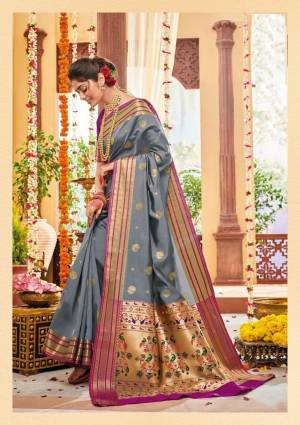 Flaunt Your Rich And Elegant Taste Wearing This Lovely Silk Based Saree In Grey Color Paired With Contrasting Purple Colored Blouse. This Saree And Blouse Are Fabricated On Banarasi Art Silk Beautified With Weave. Buy Now.