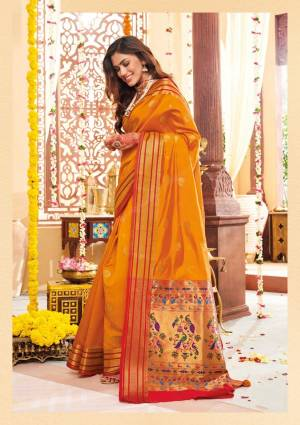 Flaunt Your Rich And Elegant Taste Wearing This Lovely Silk Based Saree In Musturd Yellow Color Paired With Contrasting Red Colored Blouse. This Saree And Blouse Are Fabricated On Banarasi Art Silk Beautified With Weave. Buy Now.