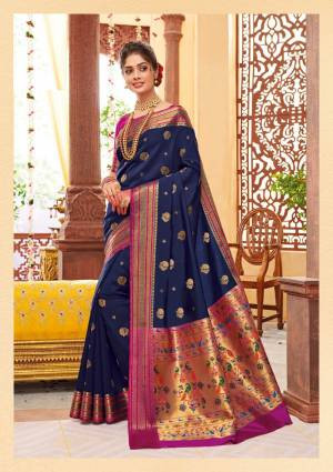 Shine Bright Wearing This Attractive Looking Saree In Navy Blue Color Paired With Contrasting Magenta Pink Colored Blouse. This Saree And Blouse Are Fabricated On Banarasi Art Silk Beautified With Weave. Buy This Saree Now.