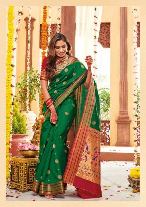 Flaunt Your Rich And Elegant Taste Wearing This Lovely Silk Based Saree In Green Color Paired With Contrasting Red Colored Blouse. This Saree And Blouse Are Fabricated On Banarasi Art Silk Beautified With Weave. Buy Now.