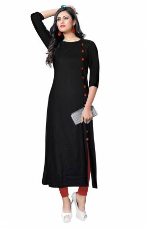 For Your Casual Wear, Grab This Simple And Elegant Looking Readymade Kurti In Black Color Fabricated On Rayon. It Is Beautified With Contrasting Buttons With A Front Side Slit. Its Fabric Is Soft Towards Skin And Available In All Regular Sizes. Buy This Pretty Kurti Now.