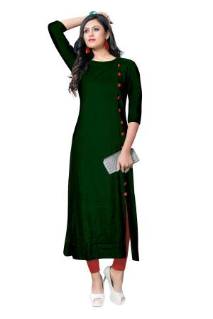 For Your Casual Wear, Grab This Simple And Elegant Looking Readymade Kurti In Dark Green Color Fabricated On Rayon. It Is Beautified With Contrasting Buttons With A Front Side Slit. Its Fabric Is Soft Towards Skin And Available In All Regular Sizes. Buy This Pretty Kurti Now.