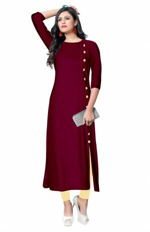For Your Casual Wear, Grab This Simple And Elegant Looking Readymade Kurti In Magenta Pink Color Fabricated On Rayon. It Is Beautified With Contrasting Buttons With A Front Side Slit. Its Fabric Is Soft Towards Skin And Available In All Regular Sizes. Buy This Pretty Kurti Now.