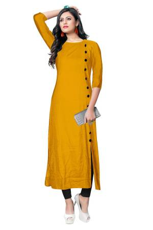 For Your Casual Wear, Grab This Simple And Elegant Looking Readymade Kurti In Musturd Yellow Color Fabricated On Rayon. It Is Beautified With Contrasting Buttons With A Front Side Slit. Its Fabric Is Soft Towards Skin And Available In All Regular Sizes. Buy This Pretty Kurti Now.