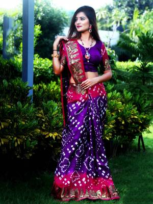Here Is A Beautiful Bandhej Designer Saree In Purple And Pink Color. This Saree And Blouse Are Fabricated On Art Silk Which Also Gives A Rich Look To Your Personality. Buy Now.