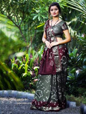 Here Is A Beautiful Bandhej Designer Saree In Grey And Wine Color. This Saree And Blouse Are Fabricated On Art Silk Which Also Gives A Rich Look To Your Personality. Buy Now.