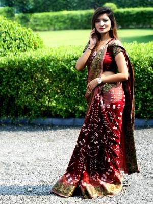 Here Is A Beautiful Bandhej Designer Saree In Red And Pink Color. This Saree And Blouse Are Fabricated On Art Silk Which Also Gives A Rich Look To Your Personality. Buy Now.