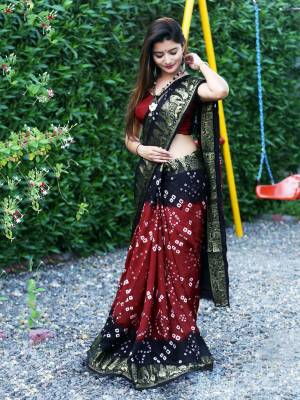 Here Is A Beautiful Bandhej Designer Saree In Maroon And Navy Blue Color. This Saree And Blouse Are Fabricated On Art Silk Which Also Gives A Rich Look To Your Personality. Buy Now.