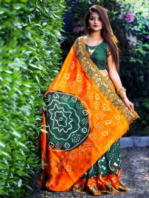 Here Is A Beautiful Bandhej Designer Saree In Teal Green And Orange Color. This Saree And Blouse Are Fabricated On Art Silk Which Also Gives A Rich Look To Your Personality. Buy Now.