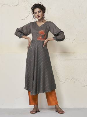You Will Definitely Earn Lots Of Compliments Wearing This Designer Readymade Kurti In Grey Color Fabricated On Rayon. It Is Soft Towards Skin And Easy To Carry All Day Long.