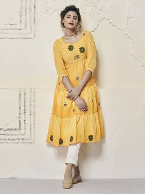 Get Ready For The Upcoming Festive Season With This Designer Readymade Kurti In Yellow Color. This A-Line Patterned Kurti Is Fabricated on Cotton Slub Beautified With Contrasting Thread Work.