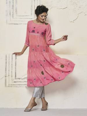 Get Ready For The Upcoming Festive Season With This Designer Readymade Kurti In Pink Color. This A-Line Patterned Kurti Is Fabricated on Cotton Slub Beautified With Contrasting Thread Work.