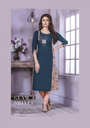 Here Is A Pretty Kurti For Your Semi-Casuals In Dark Blue Color Fabricated On Cotton. It Is Beautified With Printed patches And Thread Work And Available In All Regular Sizes.
