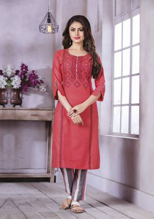 Here Is A Pretty Kurti For Your Semi-Casuals In Red Color Fabricated On Cotton. It Is Beautified With Prints And Thread Work And Available In All Regular Sizes.