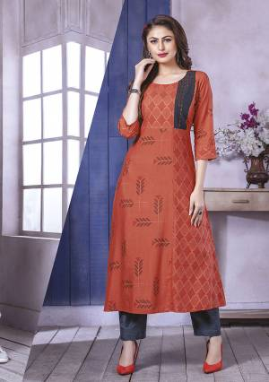 Add This Pretty Kurti To Your Wardrobe In Rust Orange Color Fabricated On Rayon. This Readymade Straight Kurti Is Available In All Regular Sizes.
