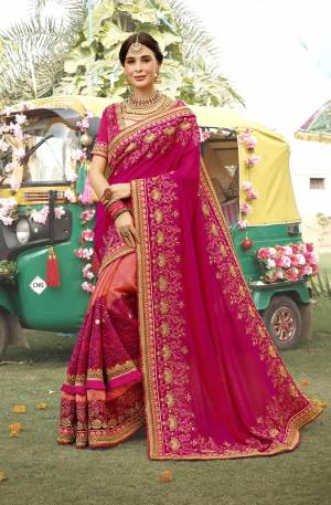 Catch All The Limelight At the Next Wedding You Attend Wearing This Heavy Designer Saree In Rani Pink And Orange Color Paired With Rani Pink Colored Blouse. This Saree And Blouse Are Silk Based Which Gives A Rich Look To Your Personality.