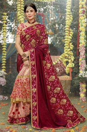 Get Ready For The Upcoming Wedding Season With This Heavy Designer Saree In Maroon And Baby Pink Color Paired With Baby Pink Colored Blouse. This Heavy Embroidered Saree And Blouse Are Silk Based With Highlight Pattern Of Embroidered Net And Attractive Satin Over The Saree Skirt. Buy This Pretty Saree Now.
