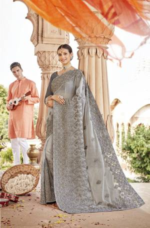 Here Is A Very Pretty Designer Saree to Add Into Your Wardrobe In Lovely Grey Color. This Heavy Embroidered Saree Is Fabricated On Chiffon Paired With Art Silk Fabricated Blouse. Buy Now.