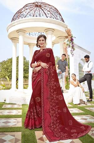 For A Royal Look, Grab This Heavy Designer Saree In Maroon Color Paired With Maroon Colored Blouse. This Saree Is Fabricated On Georgette And Brasso Paired With Art Silk Fabricated Blouse. It Is Beautified With Pretty Thread And Stone Work. Buy Now.