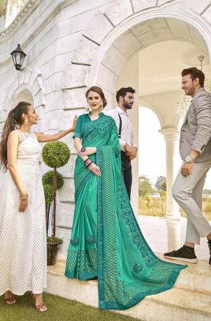 Grab This Beautiful Saree For The Upcoming Festive And Wedding Season In Sea Green Color. This Saree Is Fabricated On Satin And Brasso Paired With Art Silk Fabricated Blouse. Buy Now.