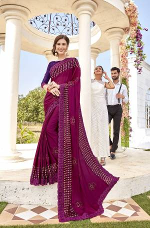 Catch All The Limelight Wearing This Heavy Designer Saree In Magenta Pink Color Paired With Purple Colored Blouse. This Saree Is Fabricated On Georgette And Brasso Paired With art Silk Fabricated Blouse.
