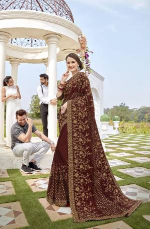 For A Royal Look, Grab This Heavy Designer Saree In Brown Color Paired With Brown Colored Blouse. This Saree Is Fabricated On Georgette And Brasso Paired With Art Silk Fabricated Blouse. It Is Beautified With Pretty Thread And Stone Work. Buy Now.
