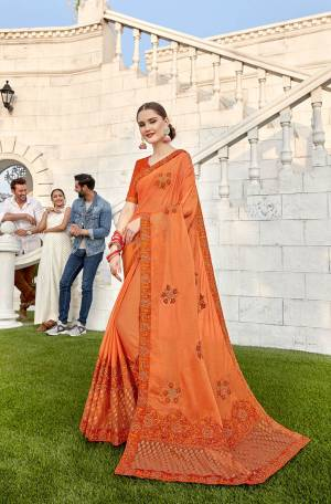 Shine Bright In This Designer Orange Colored Saree Paired With Orange Colored Blouse. This Saree Is Fabricated On Soft Silk And Brasso Paired With Art Silk Fabricated Blouse. It Is Beautified With Embroidery And Highlighted With Brasso Fabric.