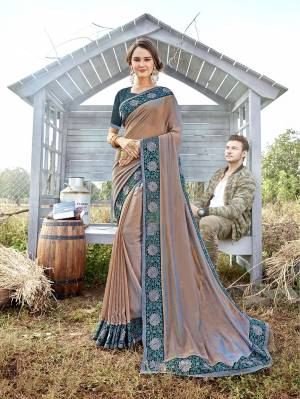 Attract All Wearing This Designer Saree In Rose Gold Color Paired With Contrasting Teal Blue Colored Blouse. This Saree Is Fabricated On Satin Georgette Paired With Art Silk Fabricated Blouse. It Is Beautified With Embroidered Lace Border And Blouse.
