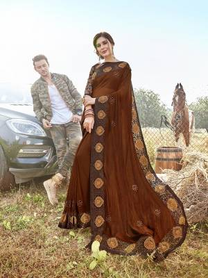 Shine Bright Wearing This Designer  Saree In Lovely Brown Color. This Saree Is Satin Georgette Based Paired With Art Silk Fabricated Blouse. Buy This Designer Piece Now.